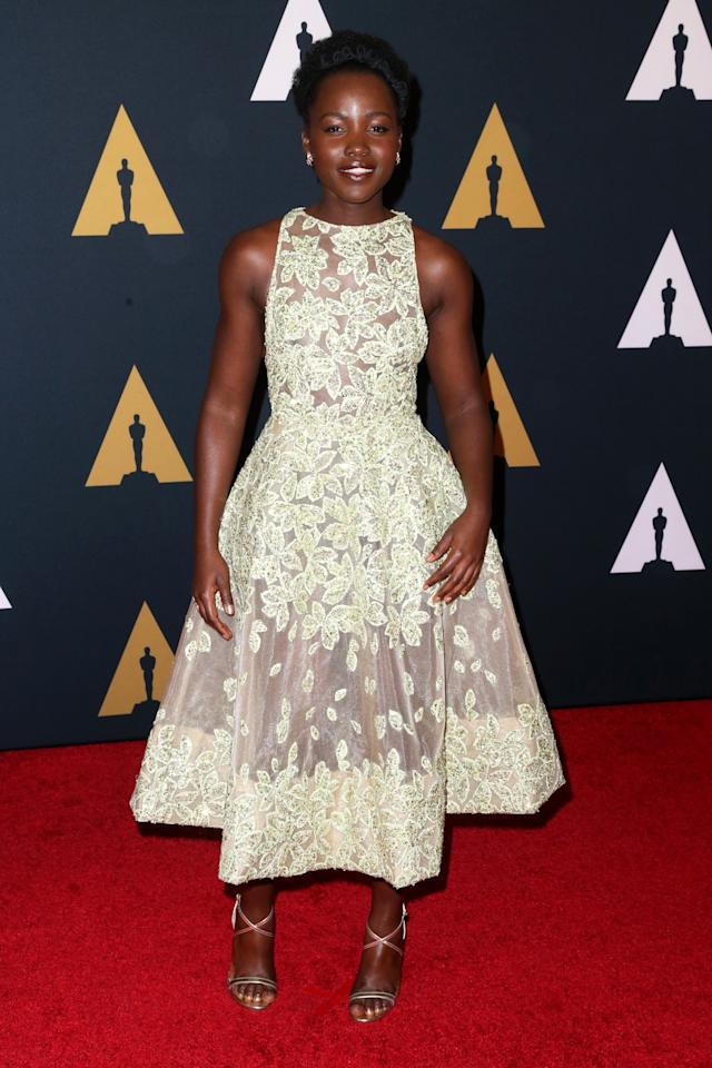 <p>Lupita Nyong'o dressed in a summery pastel shade, opting for a yellow floral gown by Elie Saab. <i>[Photo: Getty]</i> </p>