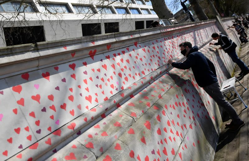 Wall of hearts being painted by volunteers and relatives of bereaved as a memorial to all those who have died so far in the UK from COVID-19, amid the spread of the coronavirus disease pandemic in London