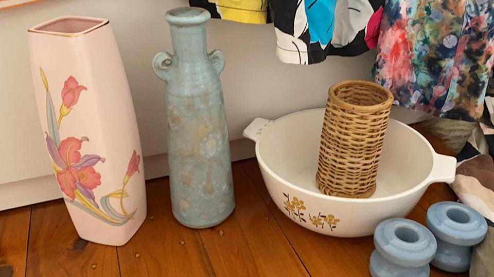A pink Japanese vase, a blue organic ceramic vase, a white baking dish and a rattan pencil holder