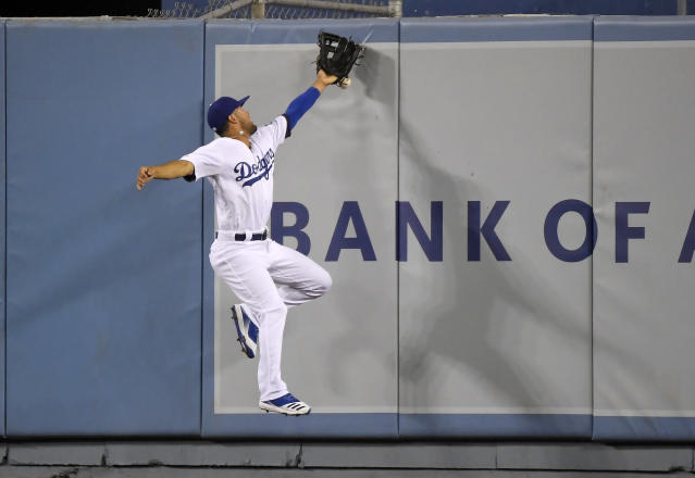 Los Angeles Dodgers center fielder Kristopher Negron can't handle a ball hit by San Diego Padres' Josh Naylor for an RBI double during the sixth inning of a baseball game Friday, Aug. 2, 2019, in Los Angeles. (AP Photo/Mark J. Terrill)