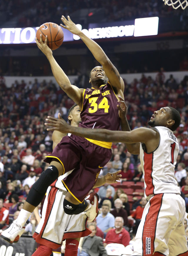 Arizona State's Jermaine Marshall shoots over UNLV's Roscoe Smith during the first half of an NCAA college basketball game on Tuesday, Nov. 19, 2013, in Las Vegas. (AP Photo/Isaac Brekken)