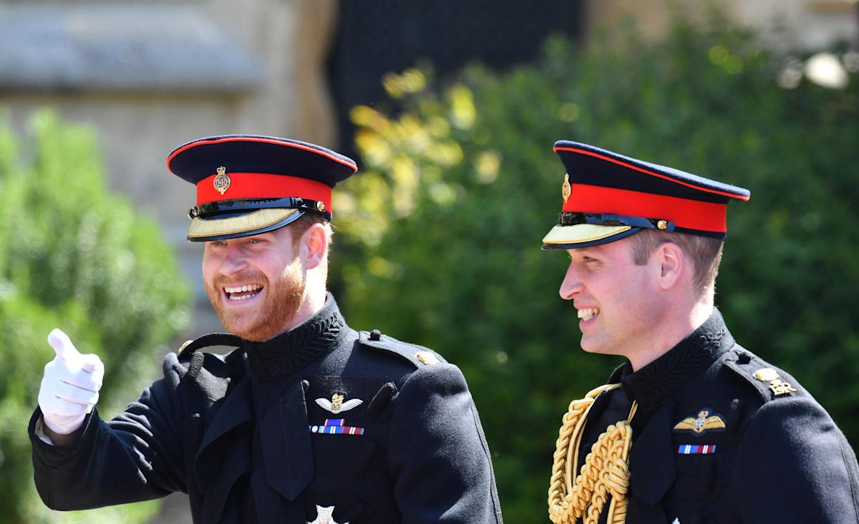 TOPSHOT - Britain's Prince Harry, Duke of Sussex, arrives with his best man Prince William, Duke of Cambridge, at the West Door of St George's Chapel, Windsor Castle, in Windsor, on May 19, 2018 for his wedding ceremony to marry US actress Meghan Markle. (Photo by Ben Birchall / POOL / AFP)        (Photo credit should read BEN BIRCHALL/AFP via Getty Images)