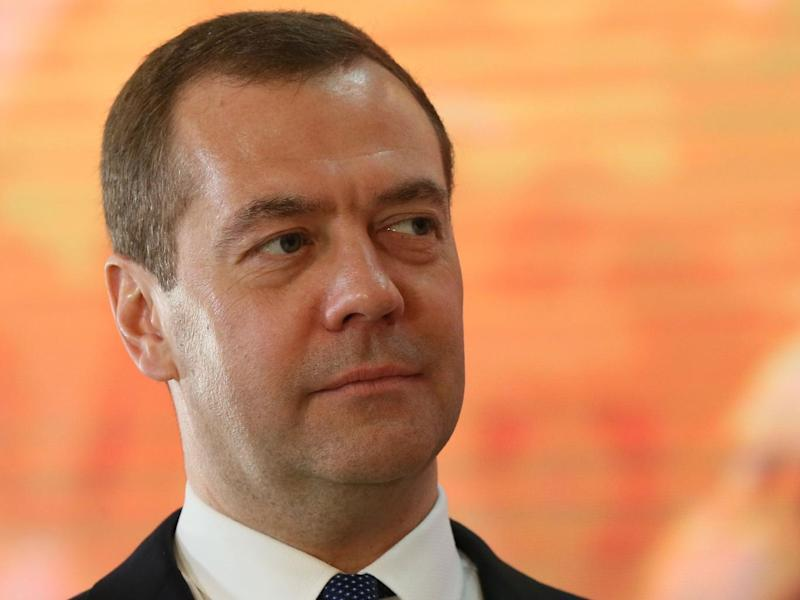 Russia's Prime Minister Dmitry Medvedev said the missiles came 'within inches' of his country's forces (Getty)