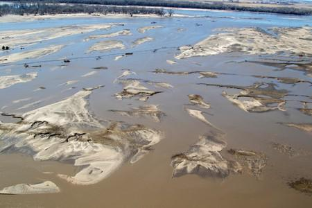FILE PHOTO:    Flooded farm fields seen from Nebraska Army National Guard CH-47 Chinook helicopter to deliver multiple bales of hay to cattle isolated by historic flooding in Nebraska