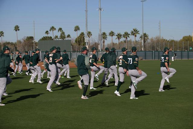 Thousands of minor leaguers are looking for answers amid the MLB shutdown. (Photo by Michael Zagaris/Oakland Athletics/Getty Images)