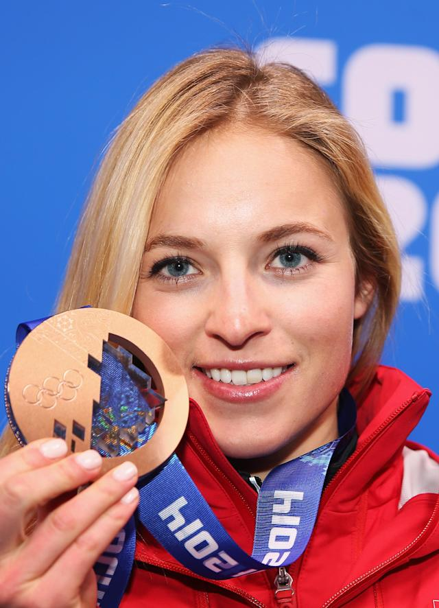 <p>Bronze medalist Lara Gut of Switzerland celebrates during the medal ceremony for the Alpine Skiing Women's Downhill on day five of the Sochi 2014 Winter Olympics at Medals Plaza on February 12, 2014 in Sochi, Russia. (Photo by Robert Cianflone/Getty Images) </p>