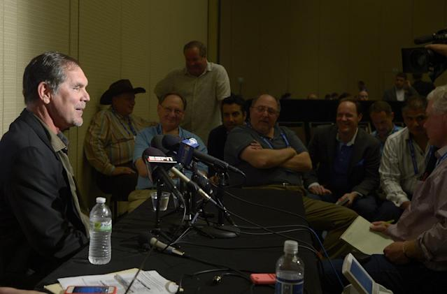 San Francisco Giants manager Bruce Bochy, left, answers a question from a reporter during a media availability at baseball's winter meetings in Lake Buena Vista, Fla., Tuesday, Dec. 10, 2013.(AP Photo/Phelan M. Ebenhack)