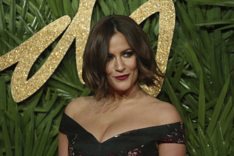 Caroline Flack poses upon arrival at The British Fashion Awards 2017 in London, Monday, Dec. 4th, 2017. (AP Photo/ Joel C Ryan)