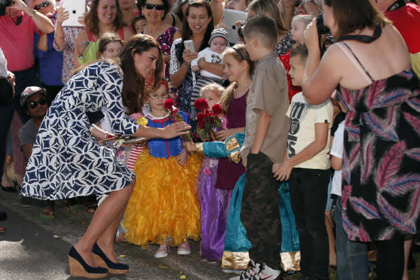 The Duchess of Cambridge receives a flower from a girl as she meets locals during her visit to the Blue Mountains suburb of Winmalee, west of Sydney, during the eleventh day of their official tour to New Zealand and Australia. PRESS ASSOCIATION Photo. Picture date: Thursday April 17, 2014. See PA story ROYAL Tour. Photo credit should read: Phil Noble/PA Wire