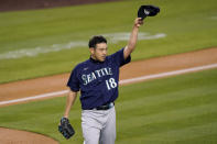 Seattle Mariners starting pitcher Yusei Kikuchi takes his hat off to right fielder Mitch Haniger after Haniger made a catch on a ball hit by Los Angeles Dodgers' Gavin Lux during the third inning of an interleague baseball game Tuesday, May 11, 2021, in Los Angeles. (AP Photo/Mark J. Terrill)