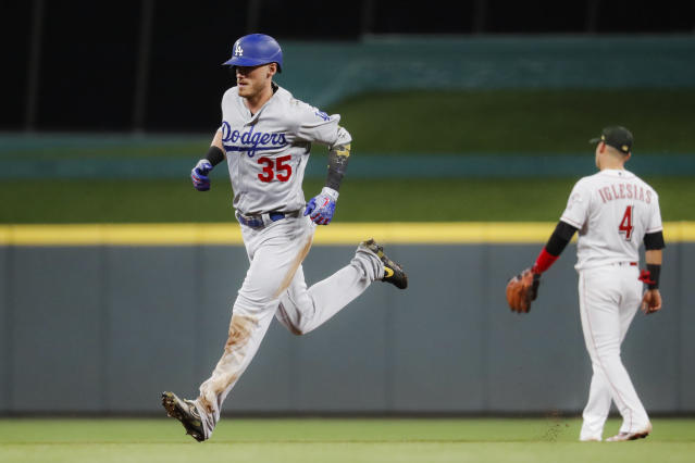Los Angeles Dodgers' Cody Bellinger (35) runs the bases after hitting a solo home run off Cincinnati Reds relief pitcher Zach Duke in the eighth inning of a baseball game, Friday, May 17, 2019, in Cincinnati. (AP Photo/John Minchillo)