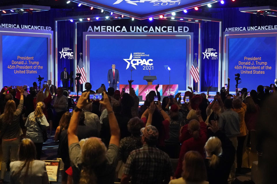 Supporters cheer and wave as former president Donald Trump is introduced at the Conservative Political Action Conference (CPAC) Sunday, Feb. 28, 2021, in Orlando, Fla. (AP Photo/John Raoux)