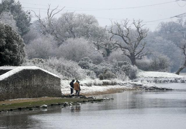 Walkers in the snow and frost in Marchwood near Southampton
