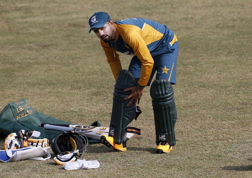 Pakistan cricket team skipper Babar Azam pads up during a practice session at the Pindi Cricket Stadium, in Rawalpindi, Pakistan, Thursday, Oct. 29, 2020. The Zimbabwe cricket team is in Pakistan to play three ODIs and three Twenty20 International match series, beginning with the first ODI on Friday. (AP Photo/Anjum Naveed)
