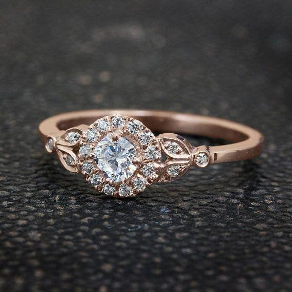 """<i>Buy it from<a href=""""https://www.etsy.com/listing/201594006/leaf-engagement-ring-18k-rose-gold-ring?ga_search_query=vintage&ref=shop_items_search_16"""" target=""""_blank"""">SillyShinyDiamondson Etsy</a>for $1,485.</i>"""