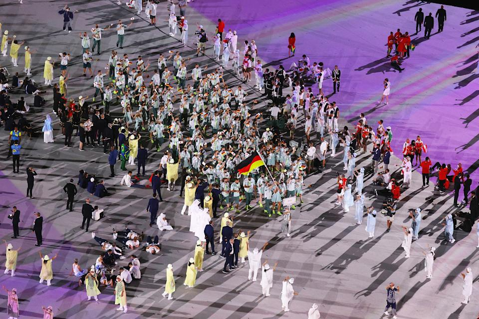 <p>TOKYO, JAPAN - JULY 23: Flag bearers Laura Ludwig and Patrick Hausding of Team Germany lead their team out during the Opening Ceremony of the Tokyo 2020 Olympic Games at Olympic Stadium on July 23, 2021 in Tokyo, Japan. (Photo by Richard Heathcote/Getty Images)</p>