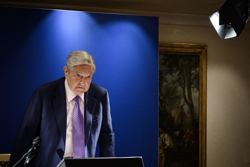 Hungarian-born US investor and philanthropist George Soros arrives to deliver a speech on the sideline of the World Economic Forum (WEF) annual meeting, on January 24, 2019 in Davos, eastern Switzerland. - Billionaire investor George Soros said, on January 24, 2019 that Chinese President Xi Jinping was 'the most dangerous enemy' of free societies for presiding over a high-tech surveillance regime. (Photo by Fabrice COFFRINI / AFP)        (Photo credit should read FABRICE COFFRINI/AFP/Getty Images)