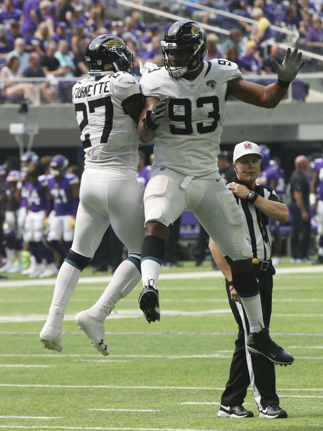 Jacksonville Jaguars running back Leonard Fournette (27) celebrates with teammate Calais Campbell (93) after scoring on a 1-yard touchdown run during the first half of an NFL preseason football game against the Minnesota Vikings, Saturday, Aug. 18, 2018, in Minneapolis. (AP Photo/Jim Mone)