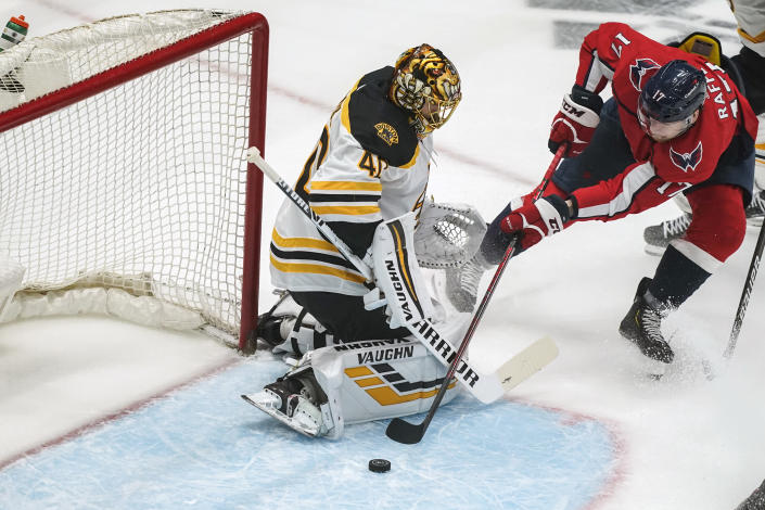 Washington Capitals left wing Michael Raffl (17) can't get the puck past Boston Bruins goaltender Tuukka Rask (40) during the first period of Game 2 of an NHL hockey Stanley Cup first-round playoff series Monday, May 17, 2021, in Washington. (AP Photo/Alex Brandon)