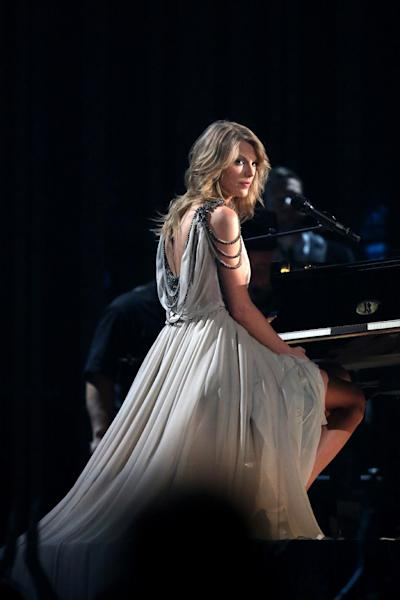 "FILE - In this Jan. 26, 2014 file photo, Taylor Swift performs ""All of Me"" at the 56th annual Grammy Awards at Staples Center in Los Angeles. Swift has had a relationship with the ""Now That's What I Call Music"" series for more than a decade. The series has reached No. 50, a serious milestone for a physical sales survivor that's managed to navigate all the changes in our digital world to remain relevant, profitable and incredibly consistent since its U.S. debut 16 years ago. (Photo by Matt Sayles/Invision/AP, file)"
