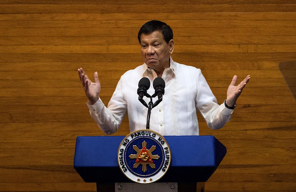 Philippine President Rodrigo Duterte gestures as he delivers his state of the nation address at Congress in Manila on July 24, 2017. Philippine President Rodrigo Duterte vowed July 24 to press on with his controversial drug war that has claimed thousands of lives, as he outlined his vision of an