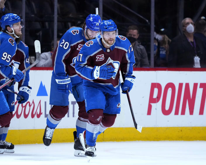 Colorado Avalanche center Tyson Jost (17) celebrates a goal against the Vegas Golden Knights during the first period in Game 2 of an NHL hockey Stanley Cup second-round playoff series Wednesday, June 2, 2021, in Denver. (AP Photo/Jack Dempsey)