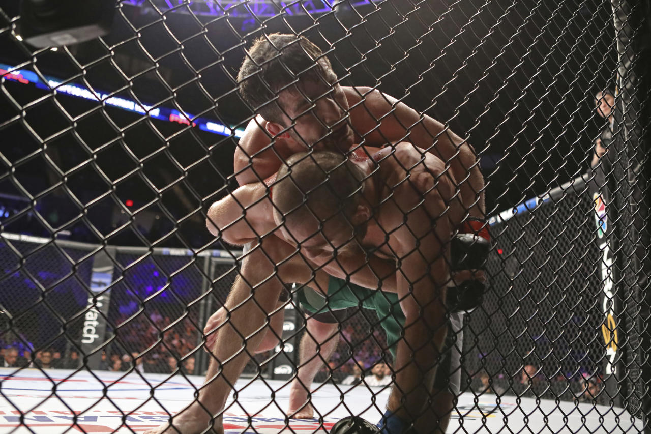 Timur Valiev, top, in action against Bekbulat Magomedov during their mixed martial arts bout at PFL 4, Thursday, July 19, 2018, at Nassau Coliseum in New York. Valiev won via decision. (AP Photo/Gregory Payan)