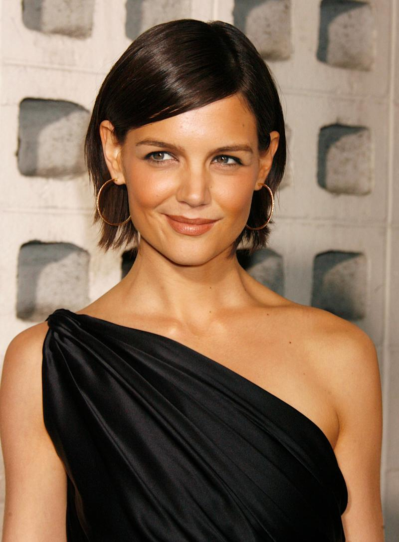 Katie Holmes poses as she arrives for a screening of a film at the opening of the AFI Fest 2007 film festival in Hollywood on Nov. 1, 2007.