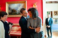 """<p>In 2009, Barack hugged his wife while in the Red Room of the White House — which is also where they <a href=""""https://www.youtube.com/watch?v=iH1ZJVqJO3Y"""" rel=""""nofollow noopener"""" target=""""_blank"""" data-ylk=""""slk:gave their last interview to PEOPLE"""" class=""""link rapid-noclick-resp"""">gave their last interview to PEOPLE</a> as POTUS and FLOTUS in 2016. </p>"""