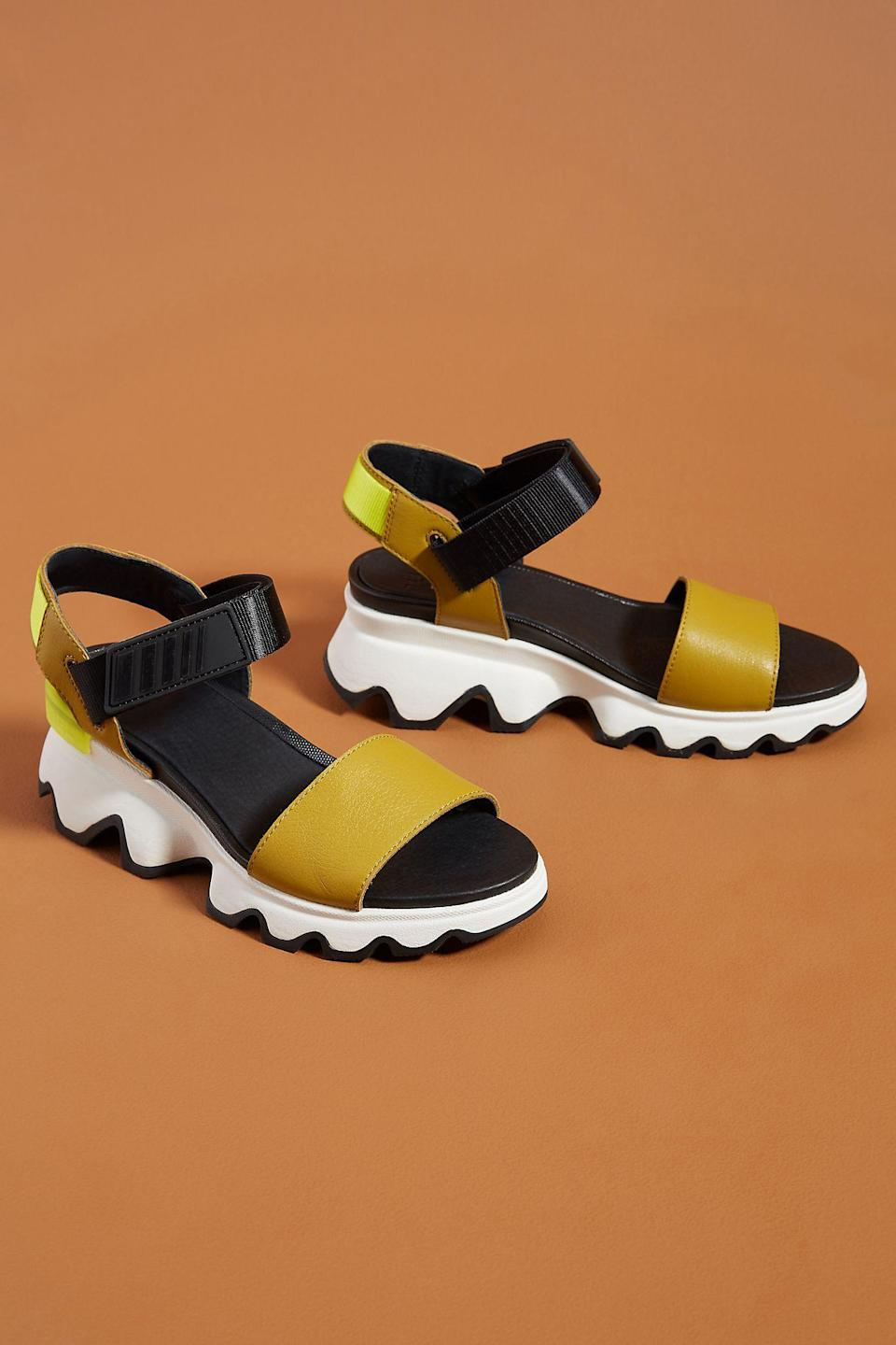 "<h2>Sorel Kinetic Sandals<br></h2><br><em>Shop sandals at <strong><a href=""https://www.anthropologie.com/shoes-sandals?style=Sport"" rel=""nofollow noopener"" target=""_blank"" data-ylk=""slk:Anthropologie"" class=""link rapid-noclick-resp"">Anthropologie</a></strong></em><br><br><strong>SOREL</strong> Sorel Kinetic Sandals, $, available at <a href=""https://go.skimresources.com/?id=30283X879131&url=https%3A%2F%2Fwww.anthropologie.com%2Fshop%2Fsorel-kinetic-sandals%3Fcolor%3D072%26type%3DSTANDARD%26quantity%3D1"" rel=""nofollow noopener"" target=""_blank"" data-ylk=""slk:Anthropologie"" class=""link rapid-noclick-resp"">Anthropologie</a>"
