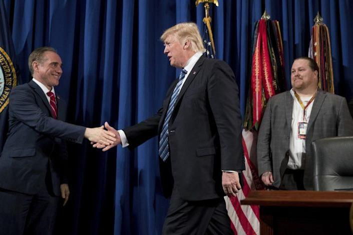 President Trump is greeted by Veterans Affairs Secretary David Shulkin, left, as he arrives to sign an executive order on improving accountability and whistleblower protection at the Department of Veterans Affairs on April 27, 2017, in Washington. At right is Brandon Coleman, a whistleblower and addiction counselor from Phoenix, Ariz. (Photo: Andrew Harnik/AP)