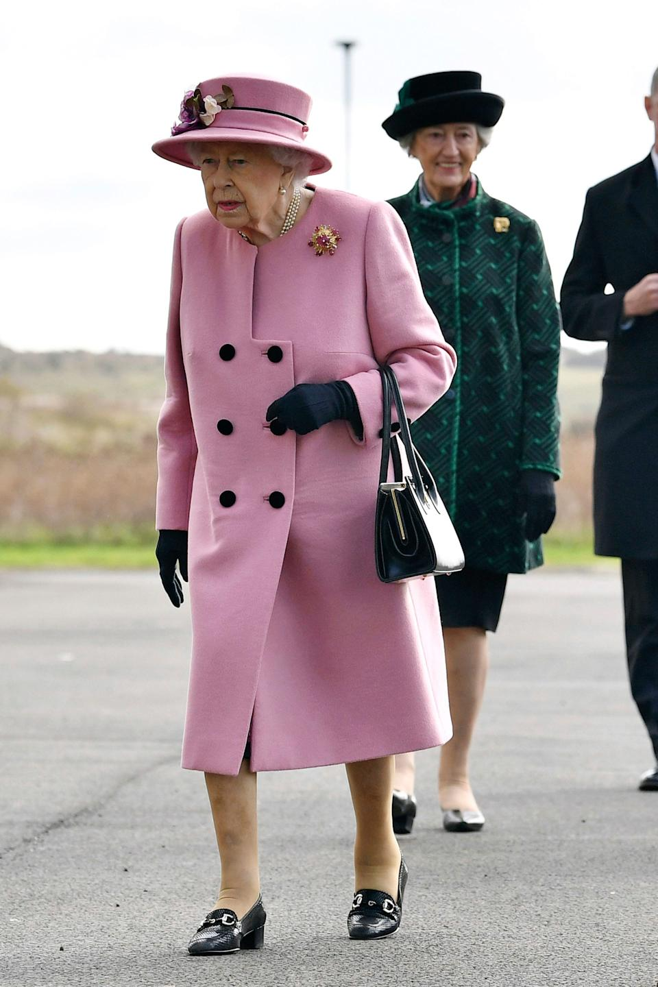 Britain's Queen Elizabeth II arrives for a visit to the Defence Science and Technology Laboratory (DSTL) at Porton Down, England, Thursday Oct. 15, 2020, to view the Energetics Enclosure and display of weaponry and tactics used in counter intelligence.