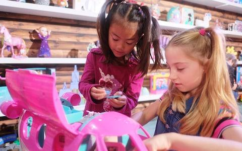 Trilyna, aged 6, and friend testing out the new Barbie toy - Credit: DreamToys