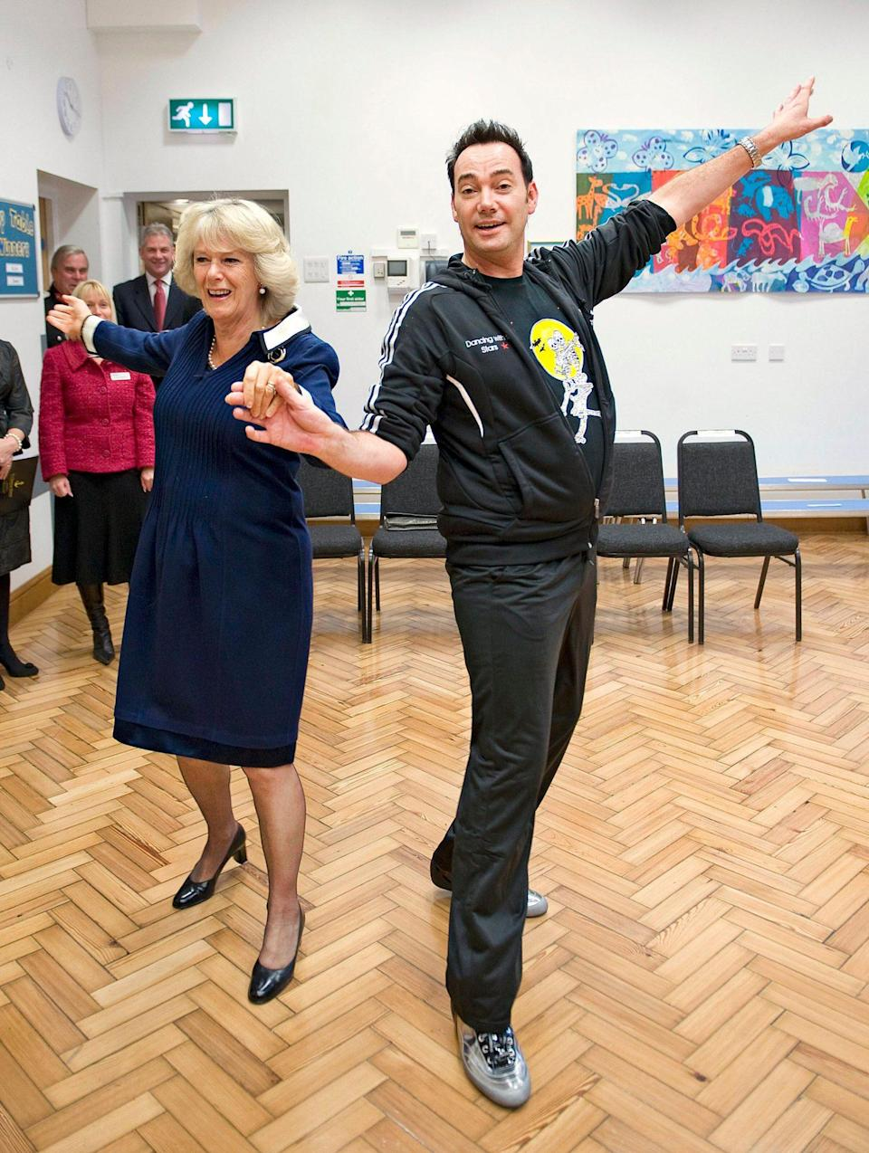 <p>The Duchess of Cornwall demonstrated her cha-cha-cha with <em>Strictly Come Dancing</em> judge Craig Revel Horwood at a primary school in London's West End as part of a 2009 National Osteoporosis Day project to encourage young people to strengthen their bones through dance and activity.</p>