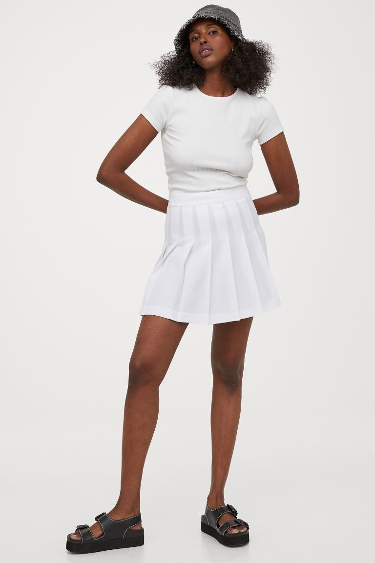 """<h2>Pleated Skirts</h2><br>Pleated skirts are a classic option for those wanting a less-sporty-more-flirty foray into golf-and-tennis style. It's a similar concept to the aforementioned skort, minus the built-short component; you can pop on a pair of breathable cotton bloomers underneath for non-active fashion wear OR pair with trusty spandex and your club/racquet of choice. <br><br><br><strong>H&M</strong> Pleated Skirt, $, available at <a href=""""https://go.skimresources.com/?id=30283X879131&url=https%3A%2F%2Fwww2.hm.com%2Fen_us%2Fproductpage.0869379020.html"""" rel=""""nofollow noopener"""" target=""""_blank"""" data-ylk=""""slk:H&M"""" class=""""link rapid-noclick-resp"""">H&M</a>"""