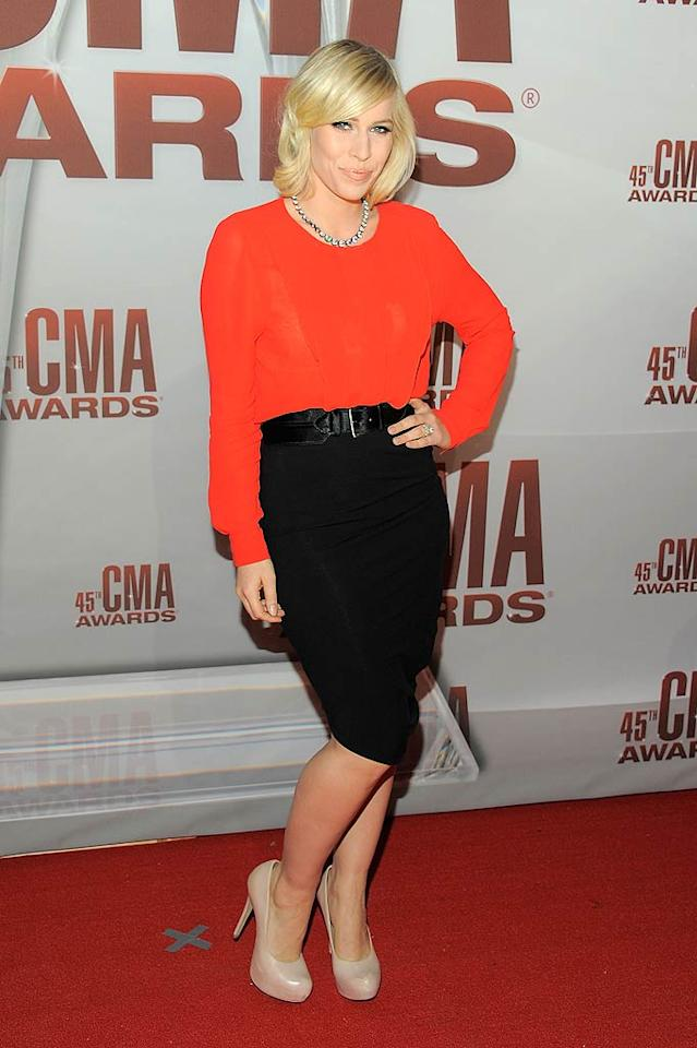 One of the evening's performers, British crooner Natasha Bedingfield, rocked a tomato-red top, pencil skirt, and nude pumps for her carpet walk. (11/8/2011)
