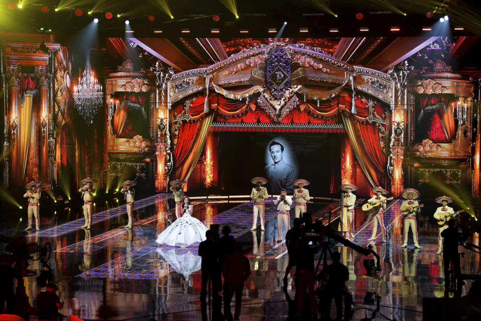 Lupita Infante and Mariachi Sol de Mexico de Jose Hernandez perform for the 21st Latin Grammy Awards, airing on Thursday, Nov. 19, 2020, at American Airlines Arena in Miami. Their performance celebrates Infante's grandfather, Pedro Infante, an icon in the Golden Era of Mexican Cinema. (AP Photo/Taimy Alvarez)