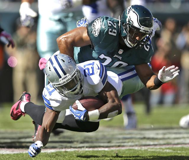 Dallas Cowboys running back Joseph Randle (21) is brought down by Philadelphia Eagles strong safety Nate Allen (29) during the first half of an NFL football game, Sunday, Oct. 20, 2013, in Philadelphia. (AP Photo/Matt Rourke)