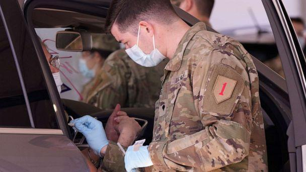 PHOTO: A soldier in a face mask prepares to administer a dose of the Pfizer's COVID-19 vaccine, March 3, 2021, in Dallas. (Lm Otero/AP)