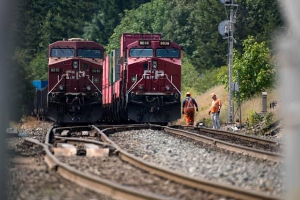 Rail lines owned by CN and CP were damaged by wildfires in B.C. last month, and that has caused their entire networks to face bottlenecks.   (James MacDonald/Bloomberg - image credit)