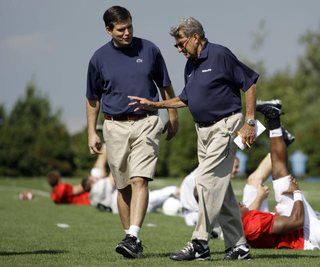 "FILE - This Aug. 8, 2008 file photo shows Penn State football coach Joe Paterno, right, walking with his son and quarterback coach Jay Paterno as players stretch out during practice in State College, Pa. Jay Paterno is the author of the book, ""Paterno Legacy: Enduring Lessons from the Life and Death of My Father."" Joe Paterno told his son the day after his firing that he hadn't informed the coaching staff about allegations Jerry Sandusky may be a child molester because he was unsure whether they were true, Jay Paterno writes in HIS new book. (AP Photo/Carolyn Kaster, File)"