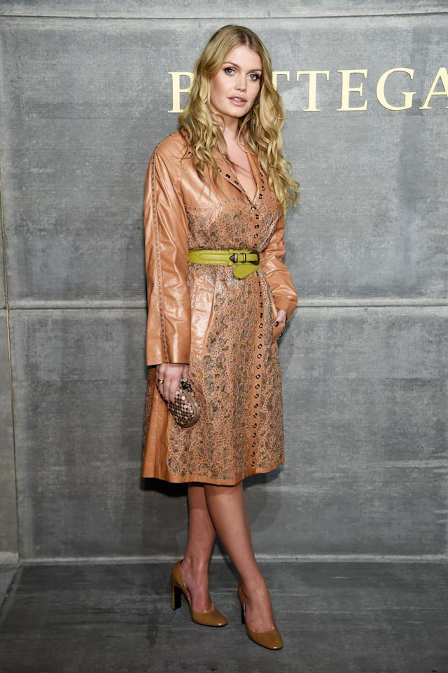<p>Sitting front row for Bottega Veneta's fashion show in New York, she wore a tan, embroidered coat from the Italian brand paired with a lime green belt. (Photo: Getty Images) </p>