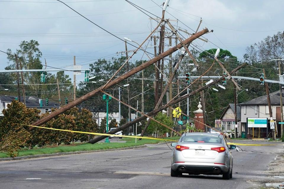 Hurricane Ida: Traffic diverts around downed power lines on August 30 (AP)