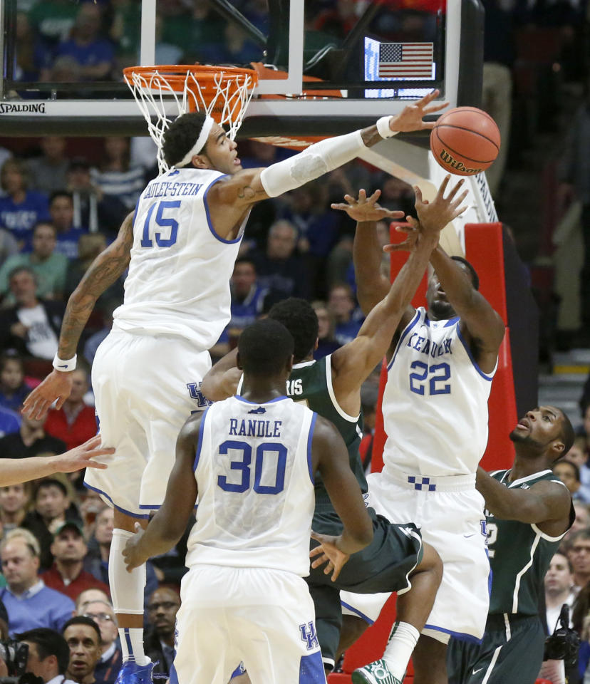 Kentucky forward Willie Cauley-Stein (15) blocks the shot of Michigan State guard Gary Harris as forwards Julius Randle (30) and Alex Poythress also defend during the first half of an NCAA college basketball game Tuesday, Nov. 12, 2013, in Chicago. (AP Photo/Charles Rex Arbogast)