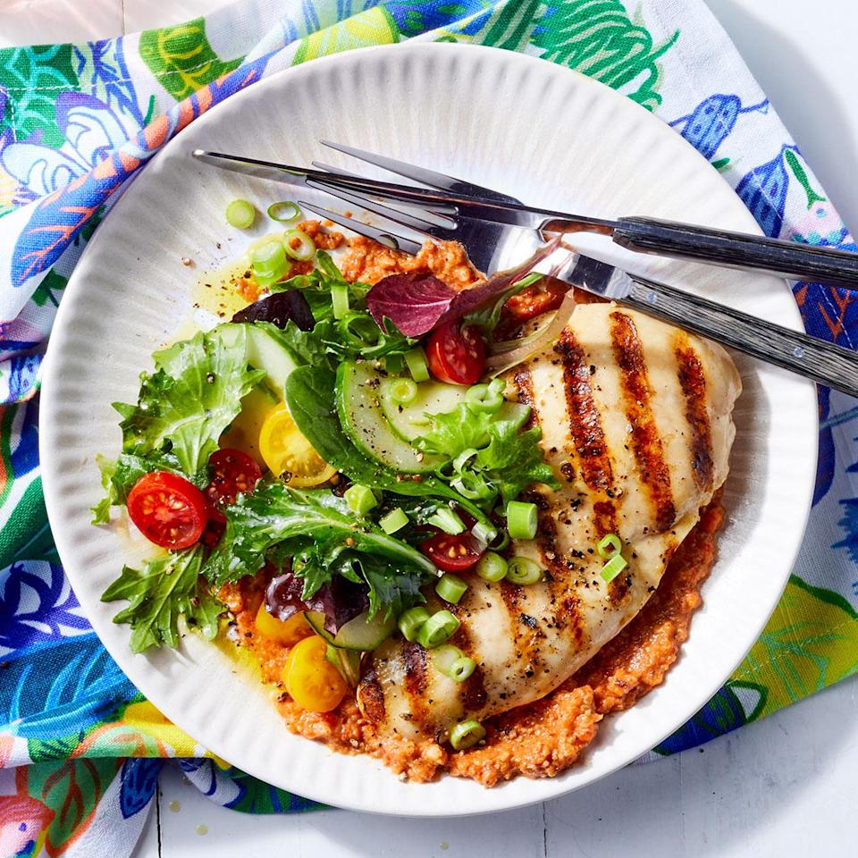 <p>Many variations of the Catalonian roasted tomato sauce, romesco sauce, add roasted red peppers for a little sweetness. Here, we scorch the peppers and tomato on the grill alongside the chicken to keep things simple.</p>