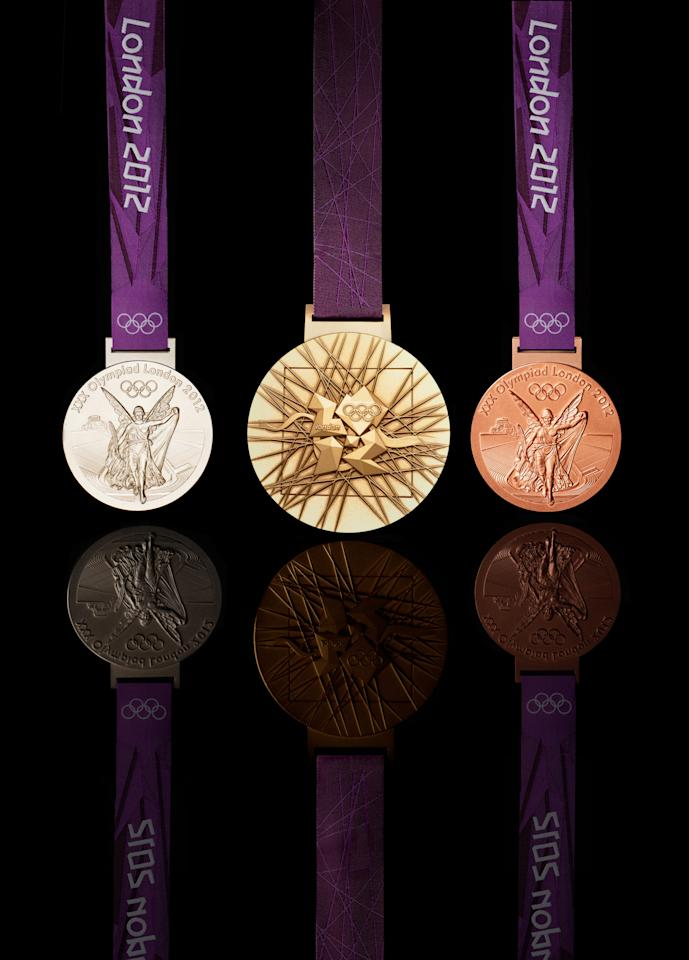 LONDON, UNITED KINGDOM -JULY 27: This handout image supplied by The London Organising Committee of the Olympic and Paralympic Games (LOCOG), shows the medals that will be awarded in the London 2012 Olympic Games, designed by British artist David Watkins. The medal depicts 'Nike', the Greek Goddess of Sport, stepping out of a scene depicting of the Parthenon and Panathinaiko Stadium. The one year countdown to the London 2012 Olympic games was marked with a unique ceremony in Trafalgar Square, with IOC President Jacques Rogge inviting the world's athletes to compete in next summer's games. (Photo by LOCOG via Getty Images)