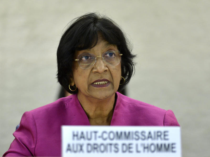 UN High Commissioner for Human Rights South African Navi Pillay addresses her statement during the urgent debate on the situation in Syria at the 23rd session of the Human Rights Council, at the European headquarters of the United Nations in Geneva, Switzerland, Wednesday, May 29, 2013. Syria's civil war is spilling out of control and represents a massive failure to protect citizens against war crimes and crimes against humanity that are now a routine occurrence according to the UN's top human rights official Pillay. (AP Photo/Keystone, Martial Trezzini)