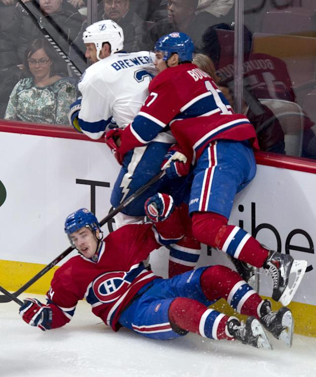 Montreal Canadiens' Michael Bournival falls as Montreal's Rene Bourque goes after Tampa Bay Lightning's Eric Brewer during the second period of an NHL hockey game Tuesday, Nov. 12, 2013, in Montreal. (AP Photo/The Canadian Press, Paul Chiasson)