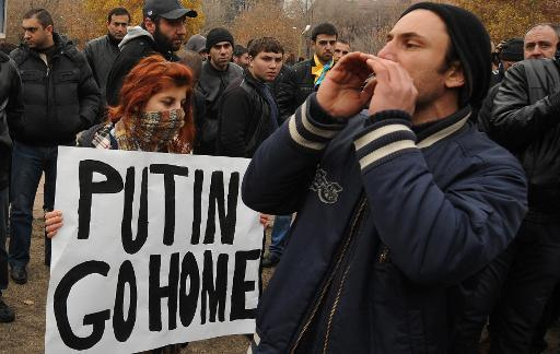 <p>Armenian anti-Putin demonstrators rally in Yerevan, on December 2, 2013, to protest a visit by the Russia's president</p>