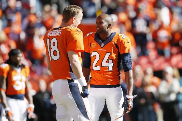 DENVER, CO - JANUARY 19: Peyton Manning #18 and Champ Bailey #24 of the Denver Broncos talk during warm-ups prior to their AFC Championship game against the New England Patriots at Sports Authority Field at Mile High on January 19, 2014 in Denver, Colorado. (Photo by Kevin C. Cox/Getty Images)